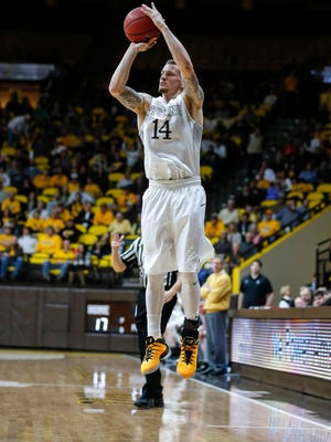 Mar 2, 2016: Wyoming Cowboys guard Josh Adams (14) shoots against the San Jose State Spartans during the first half at Arena-Auditorium.