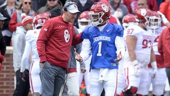 Oklahoma coach Lincoln Riley speaks to quarterback Kyler Murray during the team's spring game at Gaylord Family Memorial Stadium.