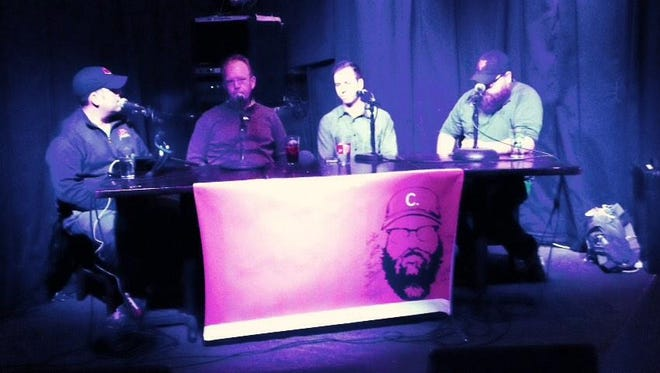Comedian Josh Sneed (far left) and Enquirer Reds writer C. Trent Rosecrans talk to MLB agents Brett and Joe Bick at MOTR Pub in Over The Rhine on Thursday.