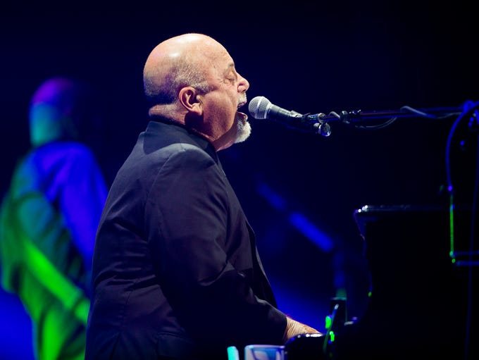 Billy Joel performs at US Airways Center in Phoenix June 1, 2014. The six-time Grammy winner was inducted to the Rock and Roll Hall of Fame in 1999.