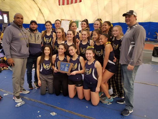The Old Tappan girls indoor track team showing off