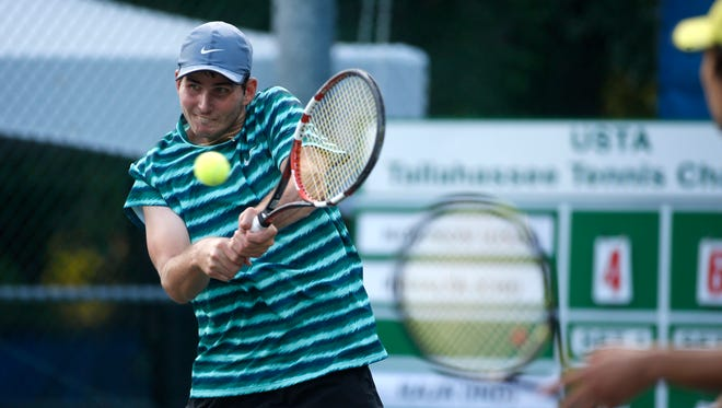 Dennis Novikov and Julio Peralta take on Purav Raja and Divij Sharan during their doubles match in the semifinal round of the USTA Tallahassee Tennis Challenger on Friday.
