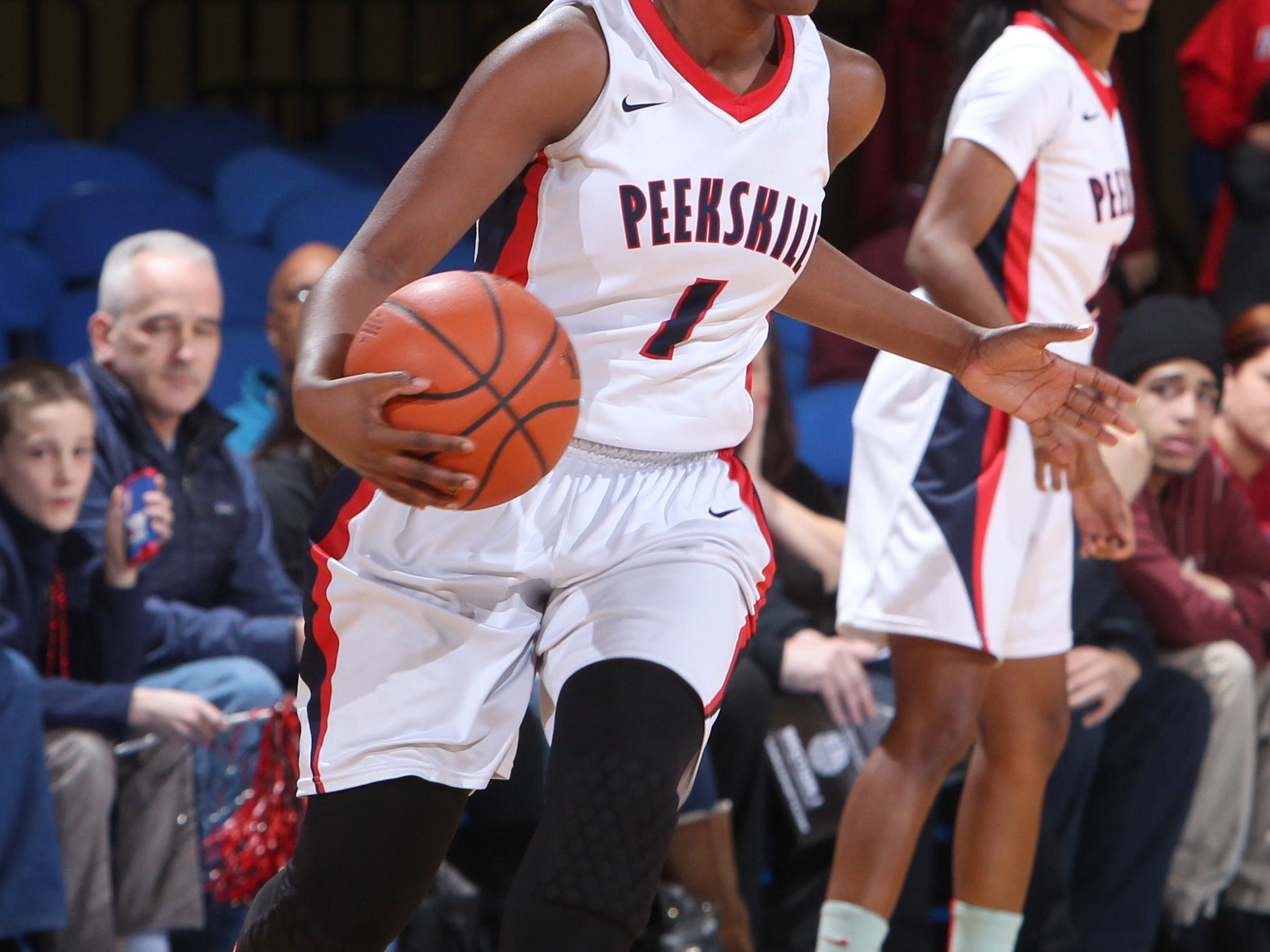 Peekskill's Lanay Rodney drives during a Section 1 Class A girls basketball semifinal with Rye at the Westchester County Center Feb. 26, 2015. Peekskill won 60-56.