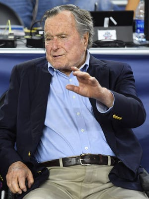 Former President George H.W. Bush had a front-row seat at the 2016 Final Four in Houston. Here, he's watching the semifinal game between Oklahoma and Villanova.
