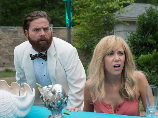 Zach Galifianakis and Kristen Wiig take on the  bank