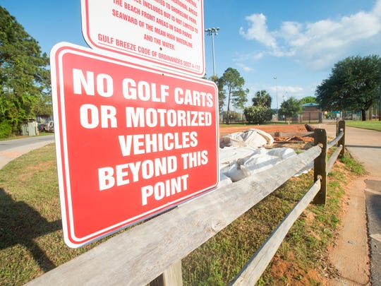 A sign prohibiting golf carts is pictured April 10 at Shoreline Park in Gulf Breeze.