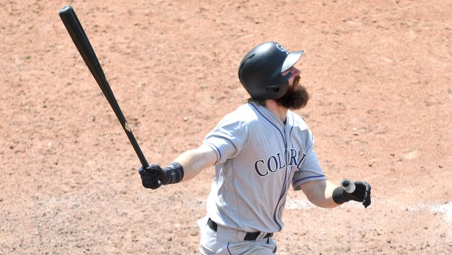 Charlie Blackmon  watches his solo home run in the 12th inning.