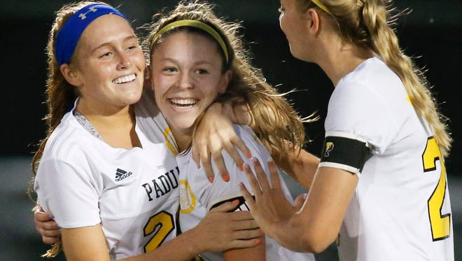 Padua's Mackzenie Scully (left) celebrates with Sarah Brush (center) and Molly Drach after Brush scored the first goal in the Pandas' 4-1 win over Caesar Rodney in the DIAA Division I state title game. Scully has been named the state's Player of the Year.