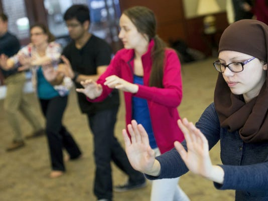 Sophomore Ameena Khairat, right, practices Tai Chi at Penn State York, offered on the first day of Unity Week at Penn State York. The 17th annual week of activities is designed to encourage diversity.