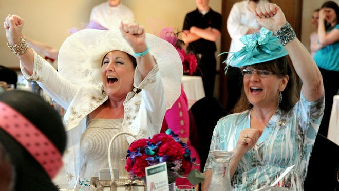 Trish Roll and Patti Jo Luedke participate in a previous year's Derby Day, a fundraiser for Beaver Dam Community Hospital.