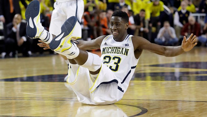 Michigan guard Caris LeVert reacts after making a basket against Illinois on Dec. 30, 2014.