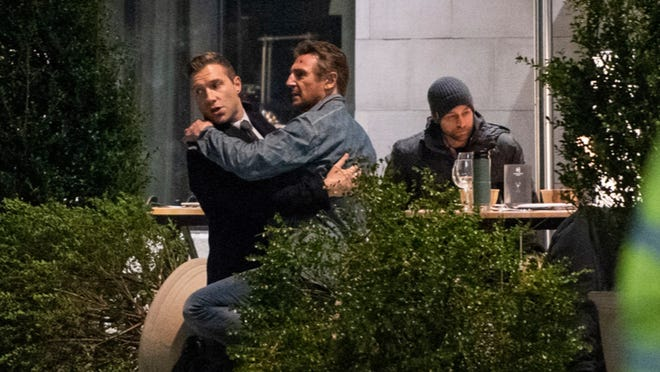 """Actor Liam Neeson, center, films his newest movie """"Honest Thief"""" outside Worcester's AC Marriott in 2018."""