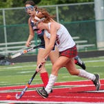Indian Hill sophomore Ally McMillan makes her move against Talawanda Aug. 25.