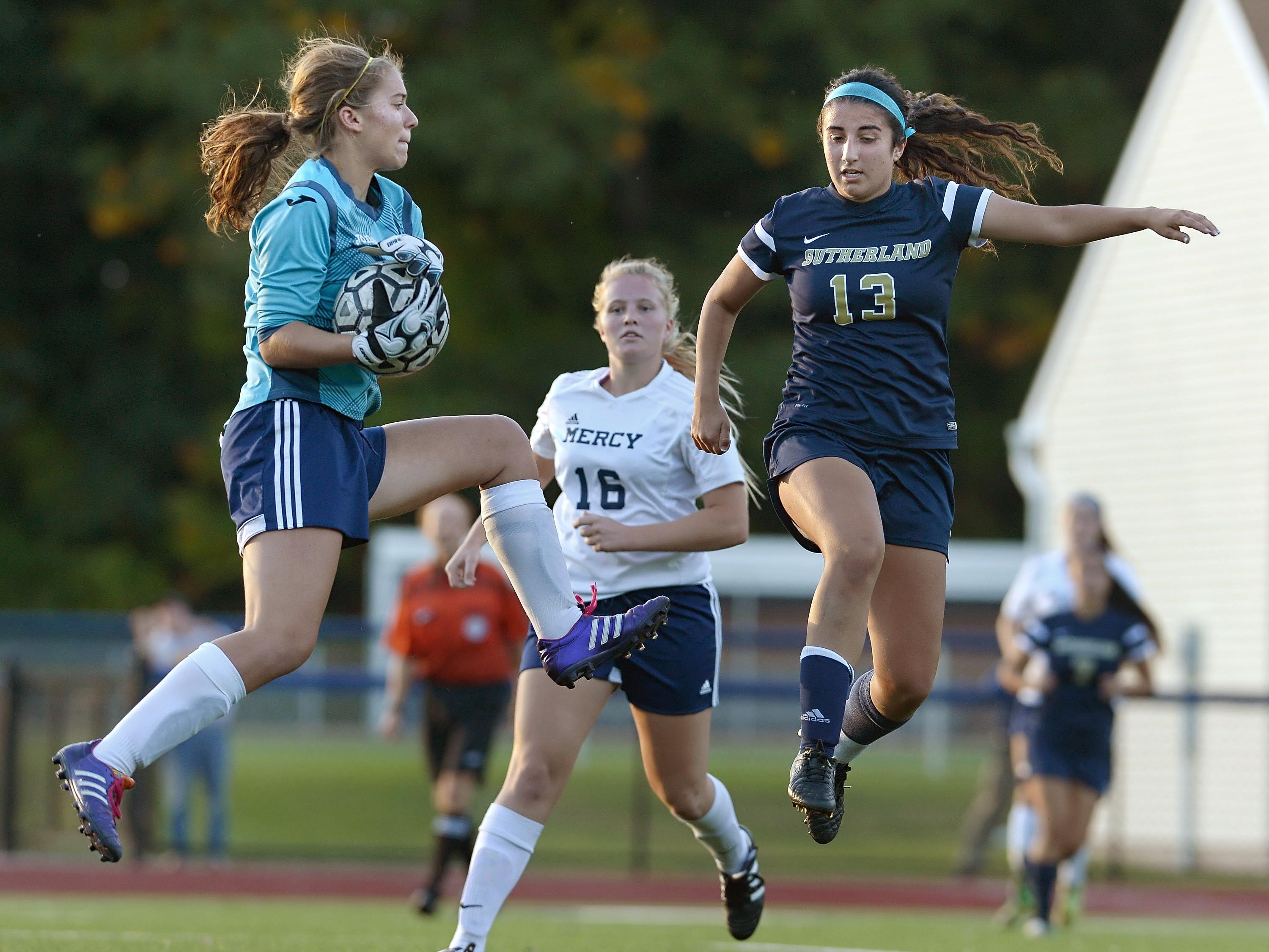 Mercy goalie Madeline Pizzo, left, makes a save with Pittsford Sutherland's Guliana Vasile approaching.