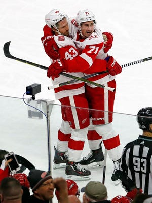 Detroit Red Wings' Darren Helm (43) is congratulated on his goal by teammate Dylan Larkin (71) during the third period.