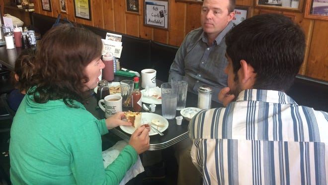 Susan Kilgore, 37, of Valley City, N.D., and Chris Kilgore, 40, of Iowa City, talk at Iowa City's Hamburg Inn No. 2 with IowaWatch reporter Matthew McDermott, right, about whether people can have a civil conversation about politics.