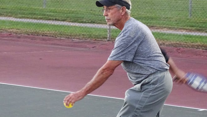 Larry Emery serves Sunday at a pickleball game at Rodger Young Park. The game, which combines elements of tennis, badminton and ping pong, is catching on in Fremont.