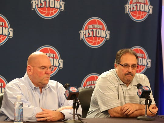 Detroit Pistons head coach and GM Stan Van Gundy, right,  and assistant GM Jeff Nix talk with reporters during a season-wrapping press conference on April 16,2015 at The Palace of Auburn Hills. The two will have a big decision on who to draft Thursday.