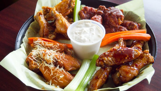 WEST VALLEY:  Booty's Wings Burgers Beer - Celebrate happy hour all day with raffle prizes and food and drink specials. Among them are 50 wings in award-winning flavors ($31.99), sliders ($2), hot dogs ($3), plates of pretzel bites ($4), cheesy garlic bread ($4), buckets of domestic beer ($11) and mimosas ($3.49). Take your pick from 15 TVs. | DETAILS: 15557 W. Bell Road, Surprise. 623-546-7757. Also, 1300 S. Watson Road, Buckeye. 623-386-3080, bootyswings.com.