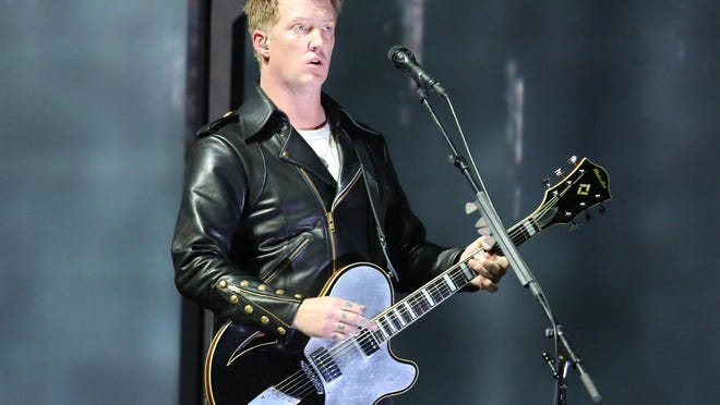 Joshua Homme, of Queens of the Stone Age, performs at the 56th annual Grammy Awards on Jan. 26, 2014, in Los Angeles. Homme, also a member of Eagles of Death Metal, was scheduled to perform Nov. 13 at the Bataclan venue in Paris. Band members Jesse Hughes and Homme told VICE on Friday that several people hid in their dressing room during the deadly terrorist attack in Paris on Nov. 13.