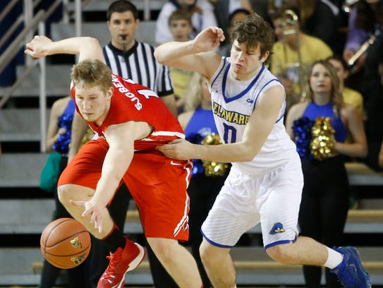Marist College's Tobias Sjoberg, left, scrambles for a loose ball against Delaware last season.