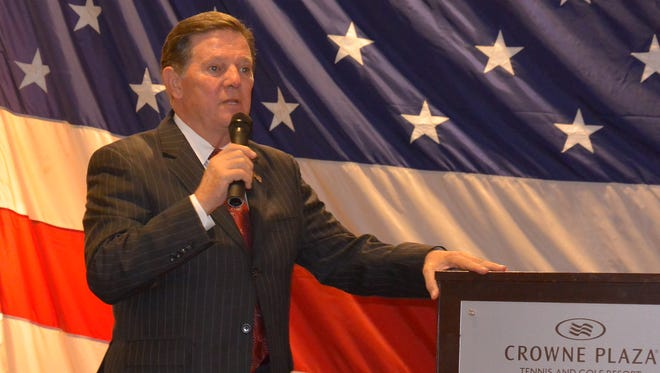 Former House Majority Leader Tom DeLay speaks at former U.S. Rep. Charles Taylor's annual holiday dinner Friday.