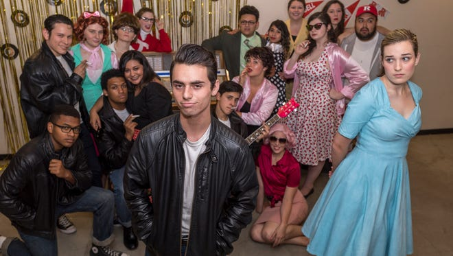"""Gracie Dodson, right, and Alex Rozier in Theater Arts Alliance's production of the musical """"Grease."""" Photo taken on Tuesday, June 13, 2017."""
