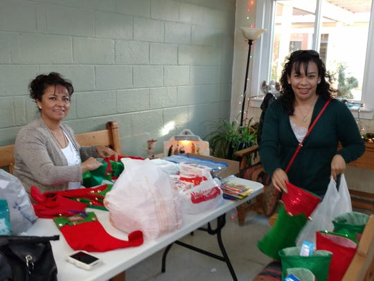 Terry Oporto, left, and Josie Dozal filled holiday