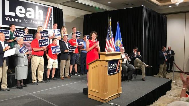 State Sen. Leah Vukmir speaks to supporters in Waukesha on Friday night as U.S. Rep. Jim Sensenbrenner and House Speaker Paul Ryan applaud.