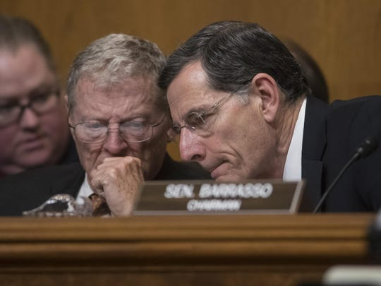 Sen. James Inhofe, right, who is worth more than $8 million, dumped $230,000 in stock after being briefed.