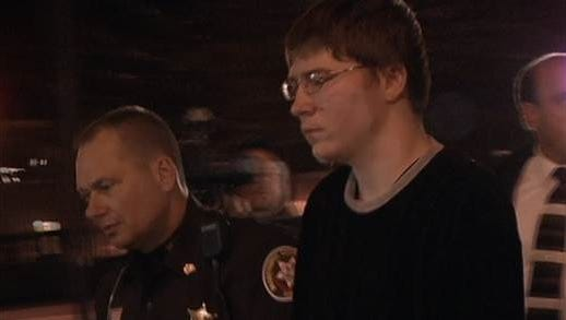Brendan Dassey is led into court moments before a jury renders its guilty verdict in 2007.