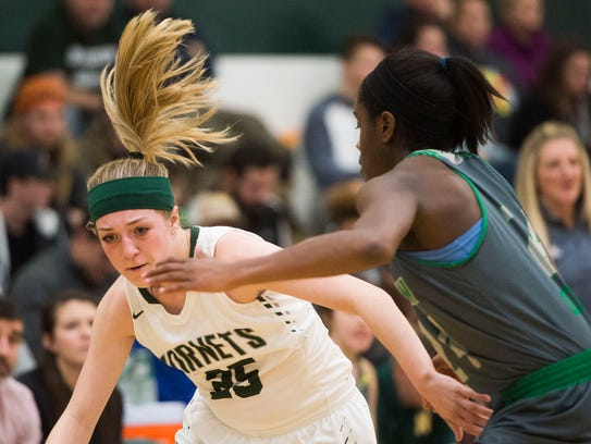 Carter's Bailey Trumm (25) charges down the court during