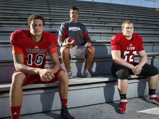 From left: Wakulla senior quarterback Feleipe Franks, the 2015 All-Big Bend Offensive Player of the Year; 10th-year Wakulla head coach Scott Klees, the 2015 All-Big Bend Coach of the Year; Leon senior defensive tackle Gabe Beyer, the 2015 All-Big Bend Defensive Player of the Year