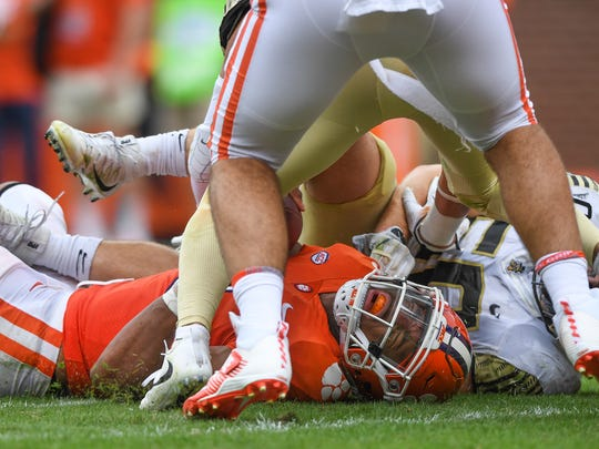 Clemson quarterback Kelly Bryant (2) lays on the turf after being injured against Wake Forest during the 3rd quarter on Saturday, October 7, 2017 at Clemson's Memorial Stadium.