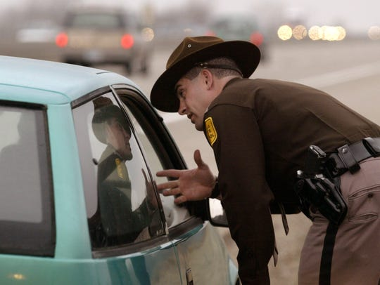 Trooper Marc Griggs pulls over a vehicle for a seatbelt