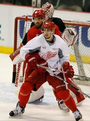 Detroit Red Wings Henrik Zetterberg holds up Tomas Jurco in front of goalie Jimmy Howard during practice for game three in NHL playoffs against the Tampa Bay Lightning on Monday, April 20, 2015, in Detroit.
