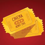 Vector illustration of two yellow cinema tickets on red