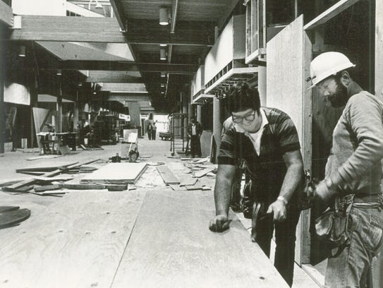 Work is done in early 1980 at the Salem Center Mall.