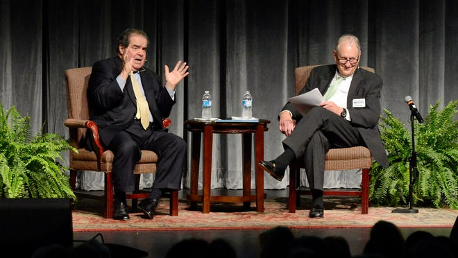 """U.S. Supreme Court Justice Antonin Scalia, left, answers a question Thursday night at Arkansas State University Mountain Home during a program titled """"A Conversation with United States Supreme Court Justice Antonin Scalia."""""""