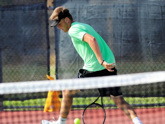 Wylie's Davyn Williford hits a shot between his legs during the USTA Texas Slam at Craig Middle School on Tuesday. Williford would win the point, but lost 6-1, 6-0 in third round of the Boys' 18 Singles consolation bracket.
