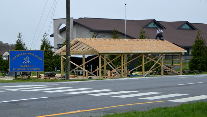 Construction crews work race against the clock to rebuild the VFW barbecue chicken shack in Ocean View.