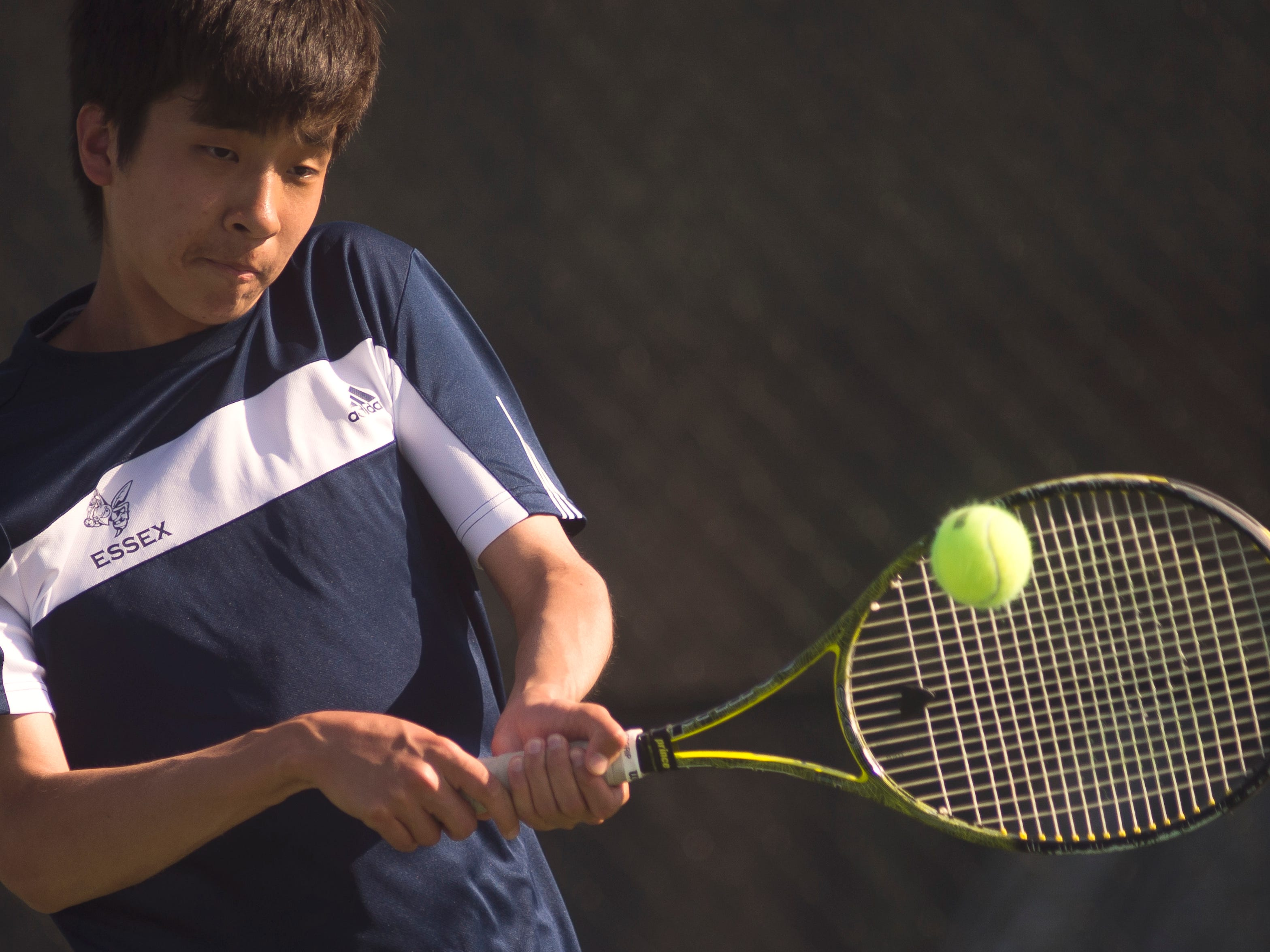 Essex second seed Daniel Ro smashed a back hand return to his St. Johnsbury opponent Salomon Zaga during their tennis match up at Essex High School Wednesday.