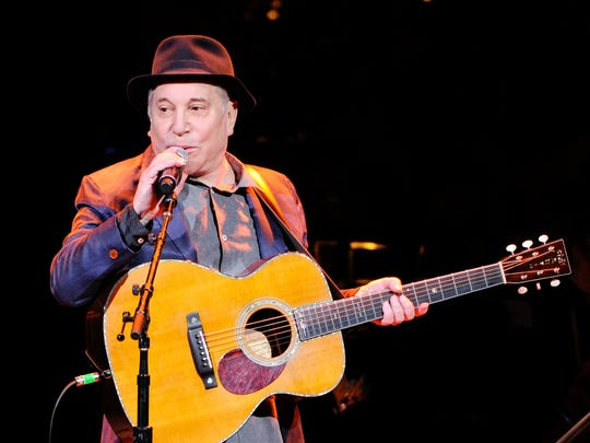Musician Paul Simon performs at the 25th Anniversary Rainforest Fund benefit concert at Carnegie Hall on Thursday, April 17, 2014 in New York. (Photo by Evan Agostini/Invision/AP)