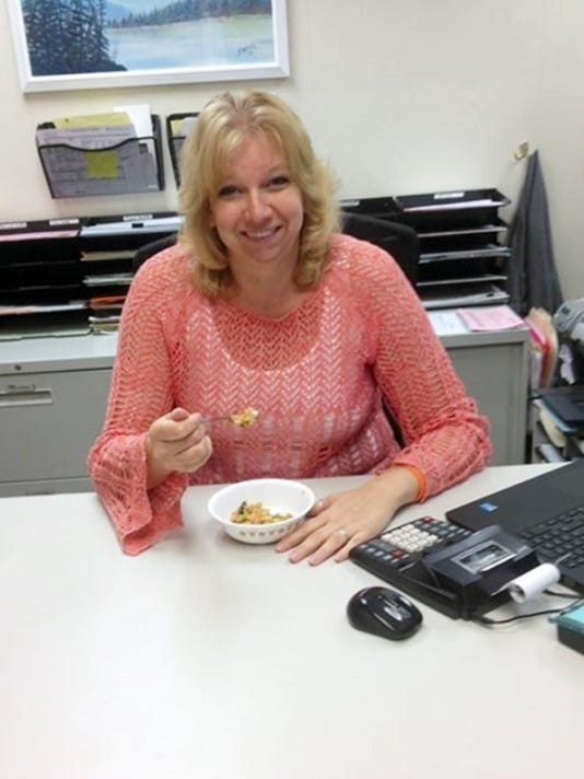 Lisa Beaver, operator of the Gettysburg Food Pantry, sits with her lunch at her desk. She is taking part in the Supplemental Nutrition Assistance Program challenge for one month. The challenge requires Beaver to live on 3.67 of food per day.