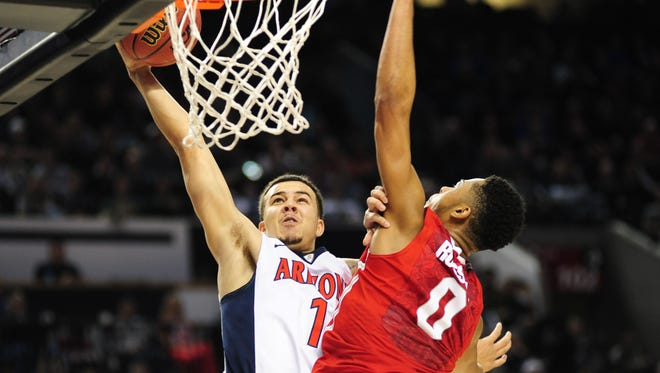 Arizona Wildcats guard Gabe York (1) drives to the basket against Ohio State Buckeyes guard D'Angelo Russell (0) during the second half in the third round of the 2015 NCAA Tournament at Moda Center in Portland, Ore., on March 21, 2015.