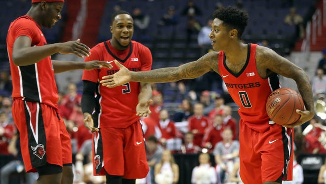 Rutgers guard Nigel Johnson (0) celebrates with Scarlet Knights forward Eugene Omoruyi (11) and Scarlet Knights guard Mike Williams (5)