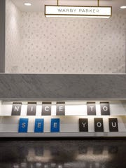 The front desk at Warby Parker in the L&C building