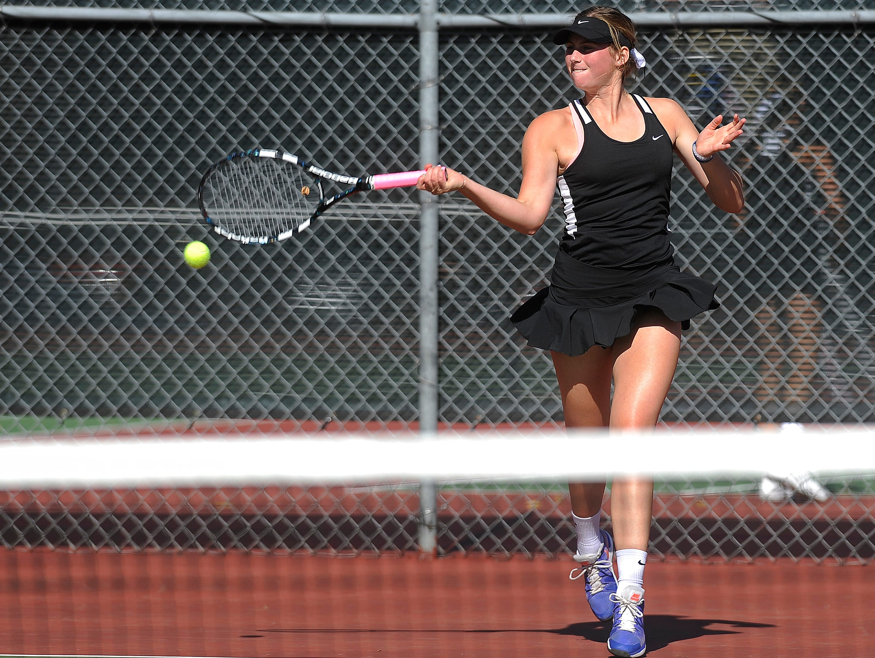 St. Thomas More's Grace Goble returns the ball to O'Gorman's Samantha Czarnecki during the singles championship finals of the SD high school girls state tennis tournament at McKennan Park in Sioux Falls, SD; Saturday, Oct. 10, 2015.
