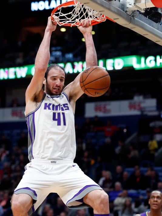 Sacramento Kings center Kosta Koufos (41) slam dunks in the first half of an NBA basketball game against the New Orleans Pelicans in New Orleans, Tuesday, Jan. 30, 2018. (AP Photo/Gerald Herbert)