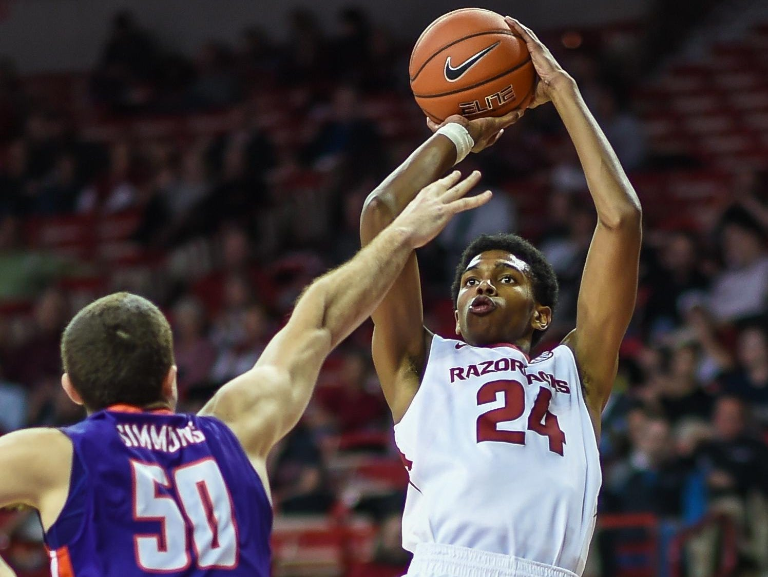 Arkansas guard Jimmy Whitt (24) shoots during a game against Evansville on Tuesday night at Walton Arena.